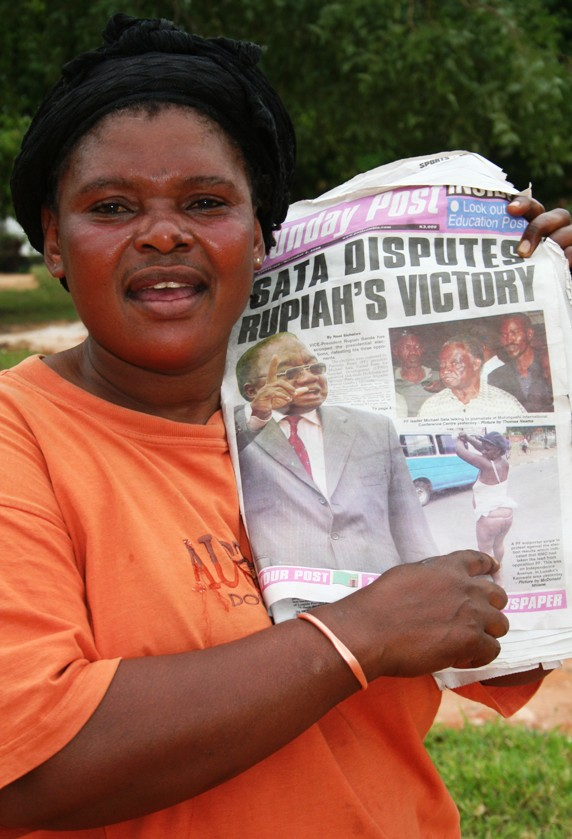 Moria displaying a copy of a newspaper carrying a picture of a naked Patriotic Front member who was protesting against the victory of the ruling MMD candidate Rupiah Banda in the October 30th, Presidential Elections